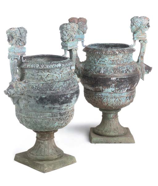A PAIR OF BRONZE TWIN-HANDLED URNS
