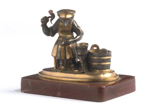 A RUSSIAN GILT-BRONZE MODEL OF A WOLF-COBBLER