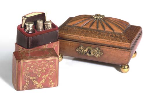 A REGENCY RED LEATHER SARCOPHAGUS-SHAPED TABLE CASKET