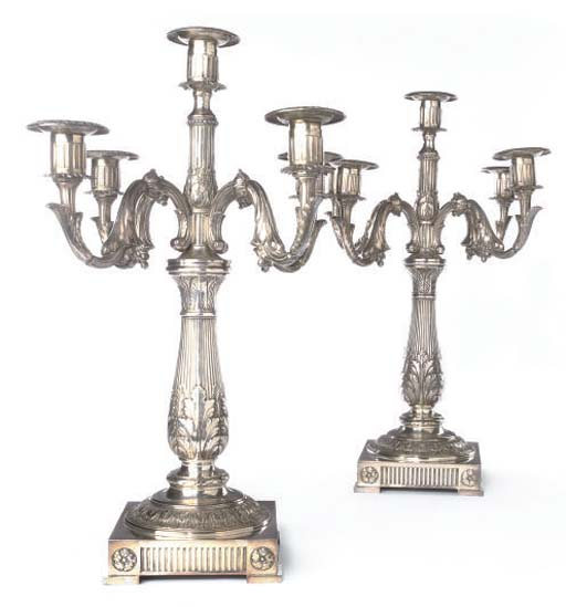 A PAIR OF SILVER PLATED FIVE-LIGHT CANDELABRA