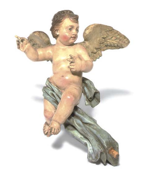 A NORTH ITALIAN CARVED AND POLYCHROME DECORATED FIGURE OF A CHERUB