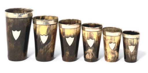 A SET OF SIX SILVER-MOUNTED HORN BEAKERS