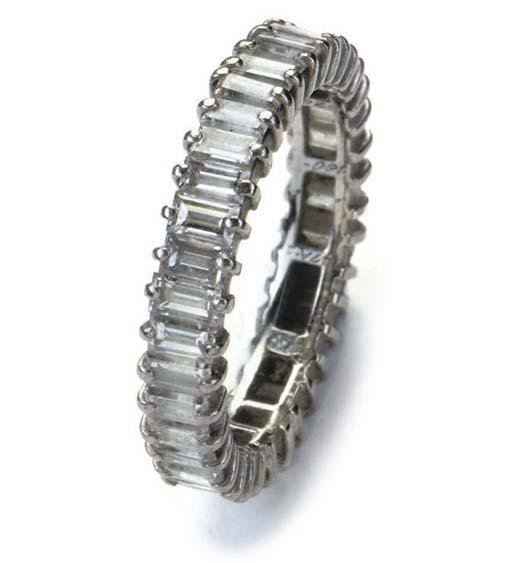 A DIAMOND ETERNITY RING BY GÜBELIN