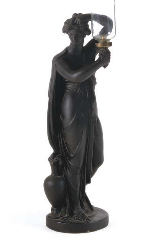 A REGENCY EBONISED PLASTER LAMP IN THE FORM OF A CLASSICAL MAIDEN
