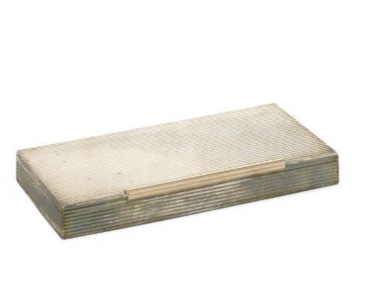 A SILVER CIGARETTE BOX BY CART