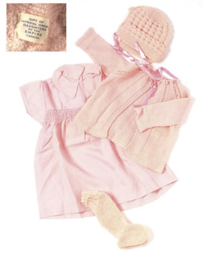 A COLLECTION OF PINK BABY CLOT