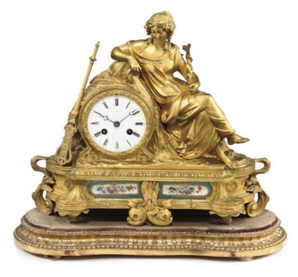 A French ormolu and porcelain-