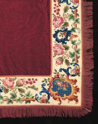 A BED COVER OF RED PLUSH WITH
