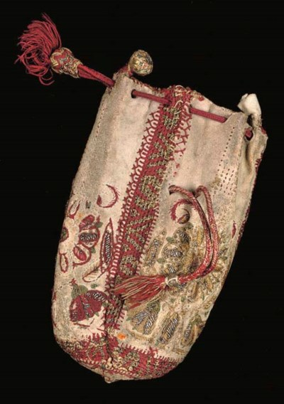 A LEATHER PURSE EMBROIDERED IN