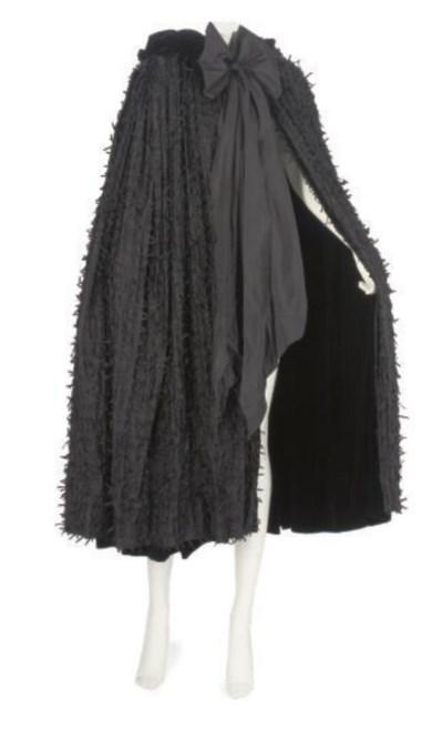 A BLACK SILK EVENING CAPE, 195