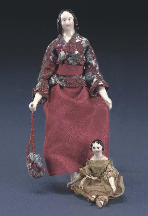 A fine china-headed dolls' hou