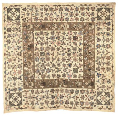 AN EARLY PATCHWORK COVERLET, E