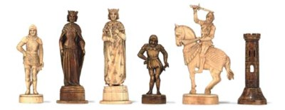 A GERMAN CARVED IVORY FIGURAL