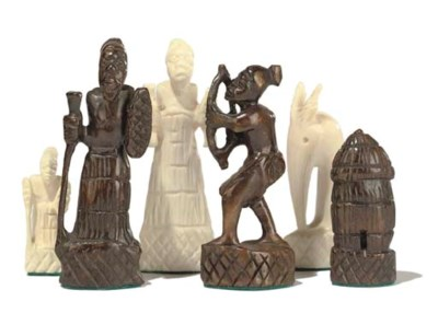 AN AFRICAN CARVED IVORY FIGURA