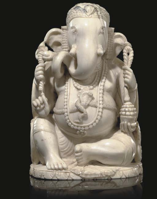 AN INDIAN CARVED IVORY FIGURE