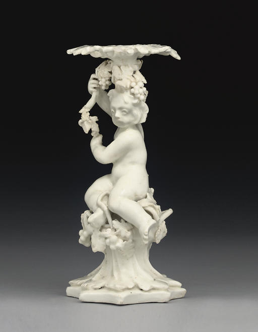 A BOW WHITE PORCELAIN PUTTO CA
