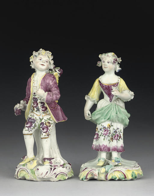TWO DERBY FIGURES OF A YOUTH A