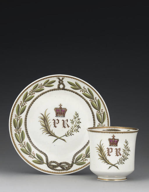 A SPODE CRESTED COFFEE-CUP AND