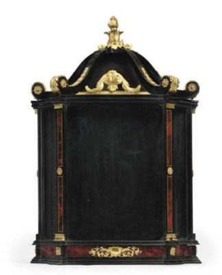 AN ITALIAN EBONISED ORMOLU MOU
