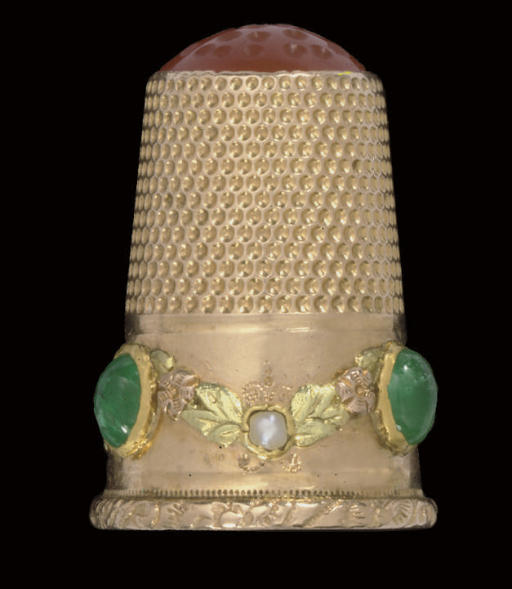A gold and emerald-set thimble