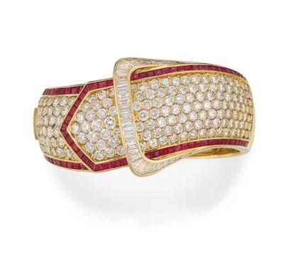 A DIAMOND AND RUBY BANGLE, BY