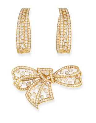 A DIAMOND BOW BROOCH AND EAR P