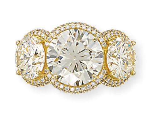A THREE-STONE DIAMOND RING, BY