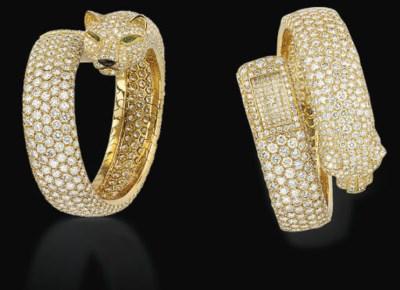 A LADY'S DIAMOND PANTHER BANGL