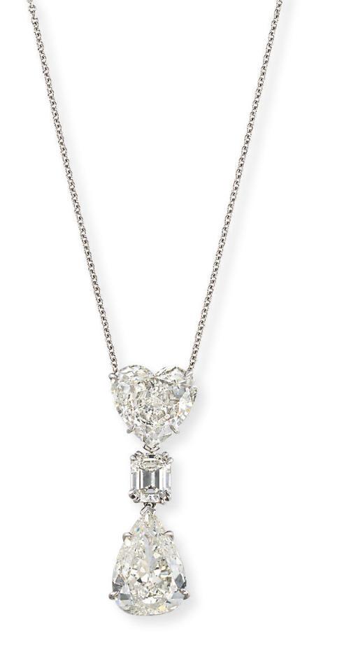 A DIAMOND THREE-STONE PENDANT