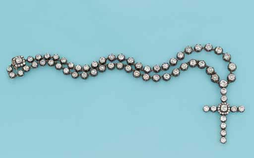 A DIAMOND PENDENT 'CROSS' NECK