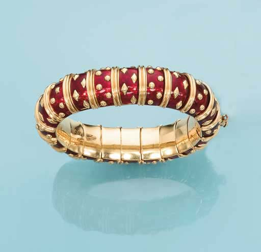 A RED ENAMEL AND GOLD BRACELET