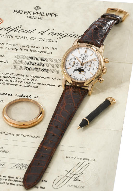 Patek Philippe. A very fine and rare 18K pink gold water-resistant perpetual calendar chronograph wristwatch with phases of the moon, original certificate and box