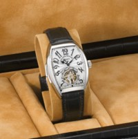 Franck Muller. A very fine, large and rare platinum tonneau-shaped curved minute repeating wristwatch with power reserve and one minute tourbillon