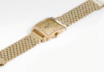 Omega. A fine 18K gold square-