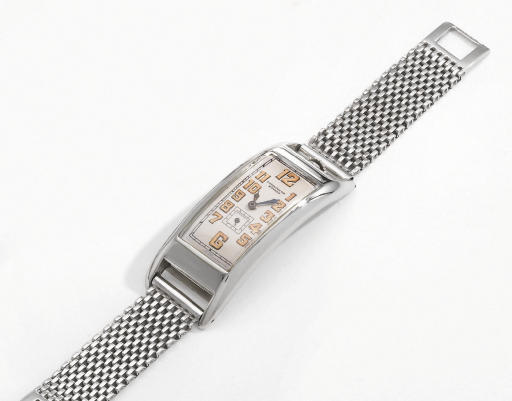 Movado. An unusual, large and early 18K white gold rectangular curved hinged wristwatch with 14K white gold bracelet
