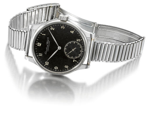 IWC. A very fine and rare stainless steel oversized wristwatch with black dial and Gay Freres bracelet
