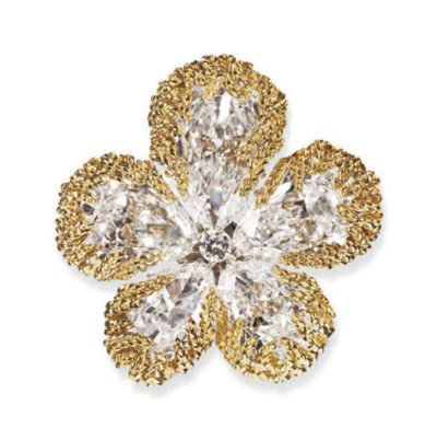 AN EXQUISITE DIAMOND AND GOLD