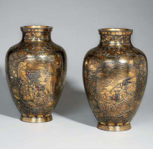 A PAIR OF IRON VASES