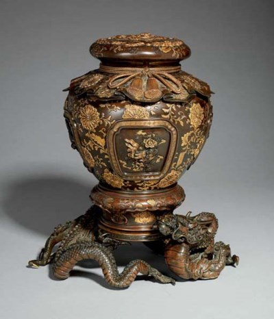 A BRONZE VASE AND COVER