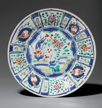 AN EARLY ENAMELLED DISH