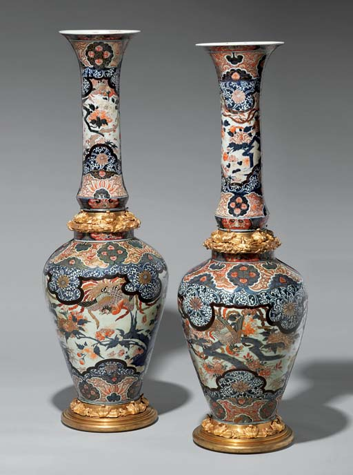 A PAIR OF ORMOLU-MOUNTED VASES
