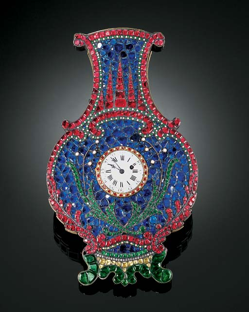 A RARE EMBELLISHED WALL VASE WITH A TIMEPIECE