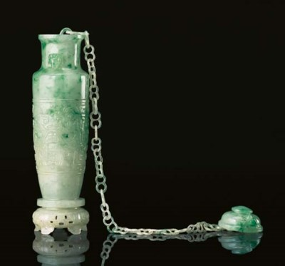 A FINELY CARVED SMALL JADEITE