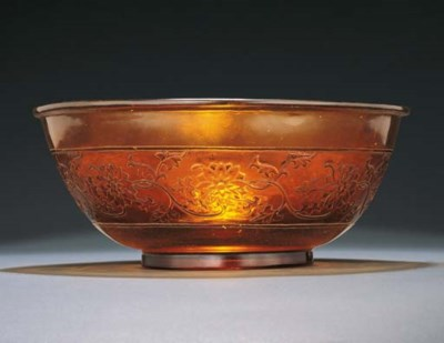AN UNUSUAL CARVED LARGE AMBER