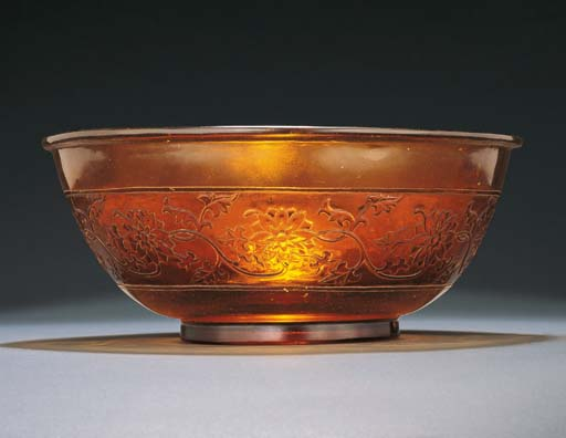 AN UNUSUAL CARVED LARGE AMBER GLASS BOWL