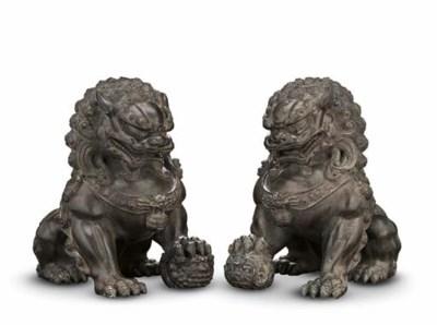 A PAIR OF BRONZE BUDDHIST LION