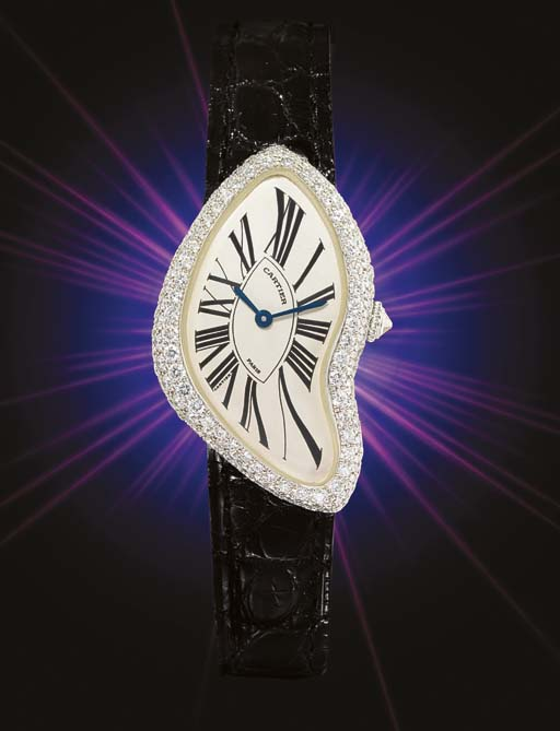 CARTIER. A FINE AND RARE LADY'S 18K WHITE GOLD AND DIAMOND-SET ASYMMETRIC WRISTWATCH