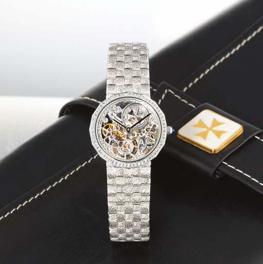 VACHERON CONSTANTIN. A LADY'S 18K WHITE GOLD AND DIAMOND-SET SKELETONISED WRISTWATCH WITH BRACELET