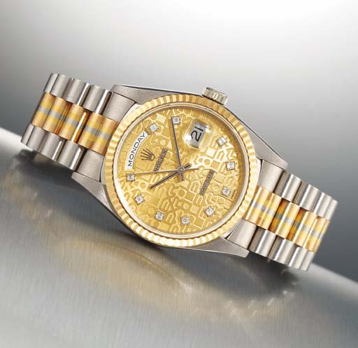 ROLEX. AN 18K THREE-COLOURED GOLD AND DIAMOND-SET AUTOMATIC DAY-DATE WRISTWATCH WITH CENTRE SECONDS AND BRACELET
