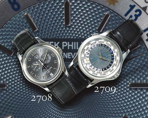 PATEK PHILIPPE. A FINE PLATINUM AUTOMATIC WORLD TIME WRISTWATCH WITH 24 HOUR INDICATION